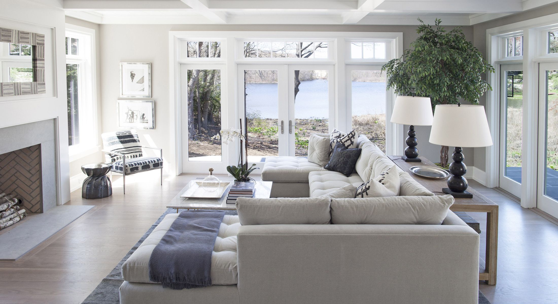 Family room seating and large painless windows set on for Living room 4 doors