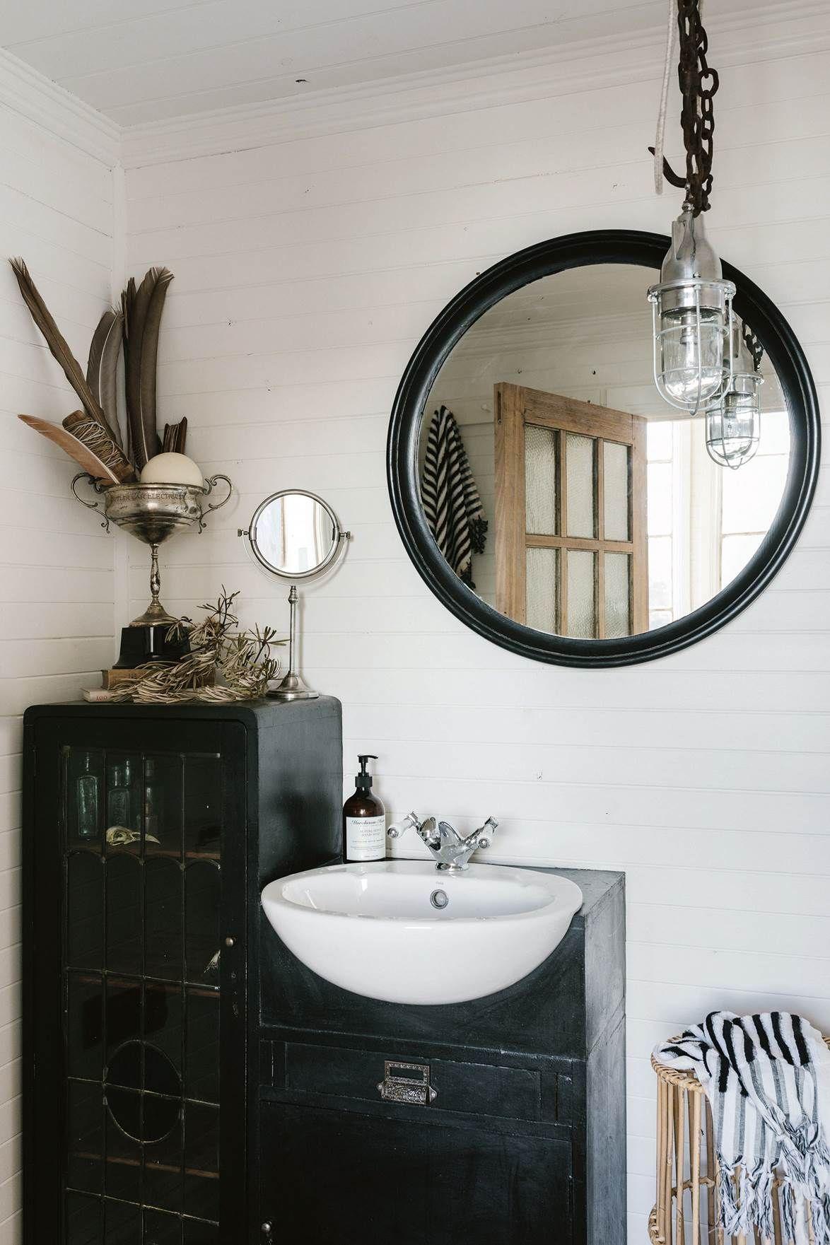 Inside Captain S Rest Tasmania S Cosiest Airbnb Cottage Bathroom Light Fixtures Bathroom Decor Round Mirror Bathroom