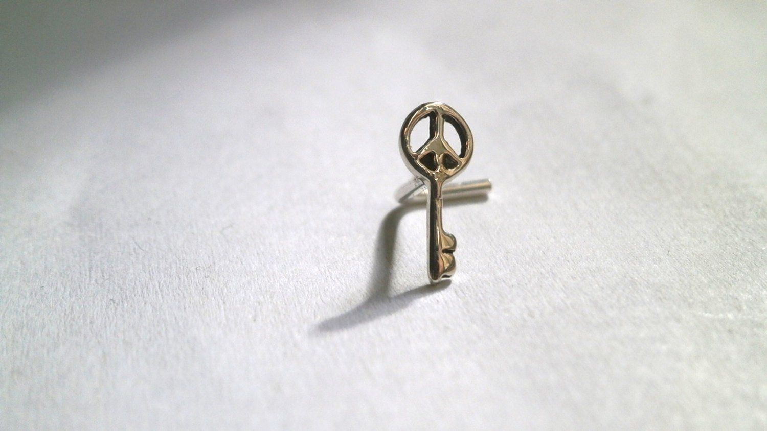 Nose piercing post  Tiny Nose Stud Silver Stud Peace Key Post Earring Tragus