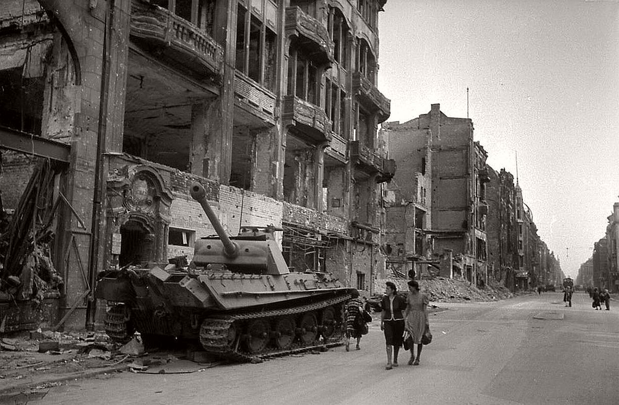 A disabled German Panther tank on the streets of postwar Berlin. Note that all the outer wheels are missing.