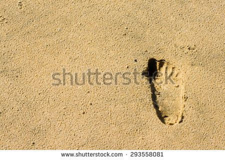 Footprints of a child in the sand. - stock photo