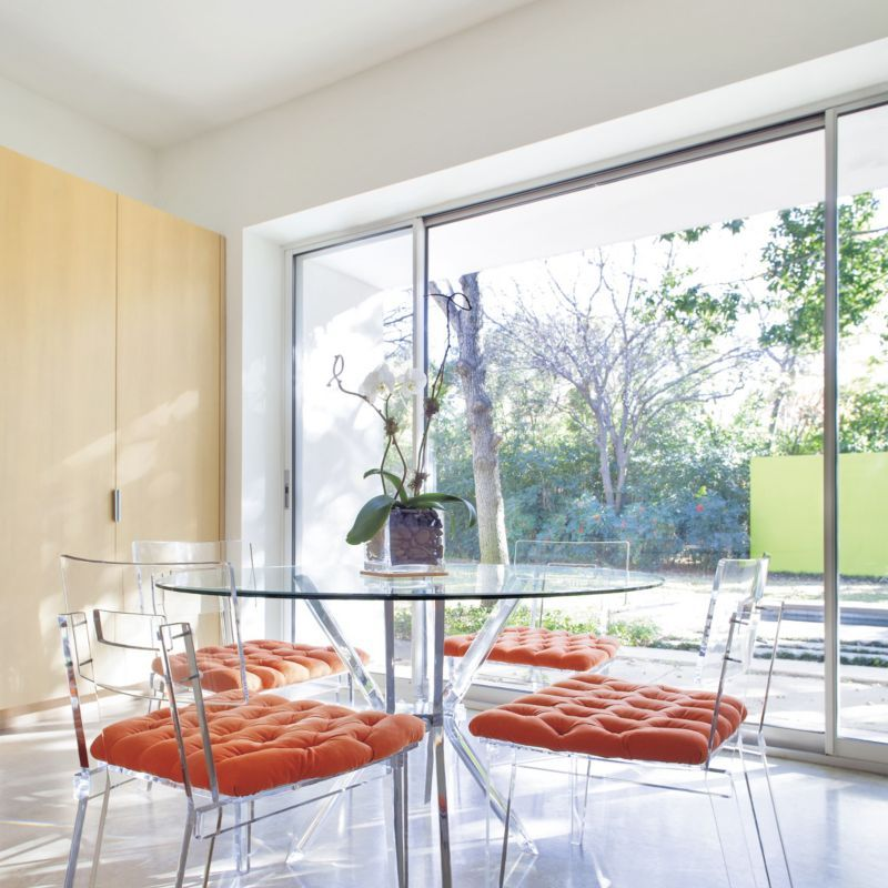 Breakfast Room with Lucite Table and Orange Cushions ...