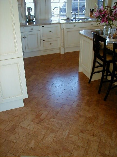 White Cabinets And Cork Floor In Herringbone Pattern Gives This
