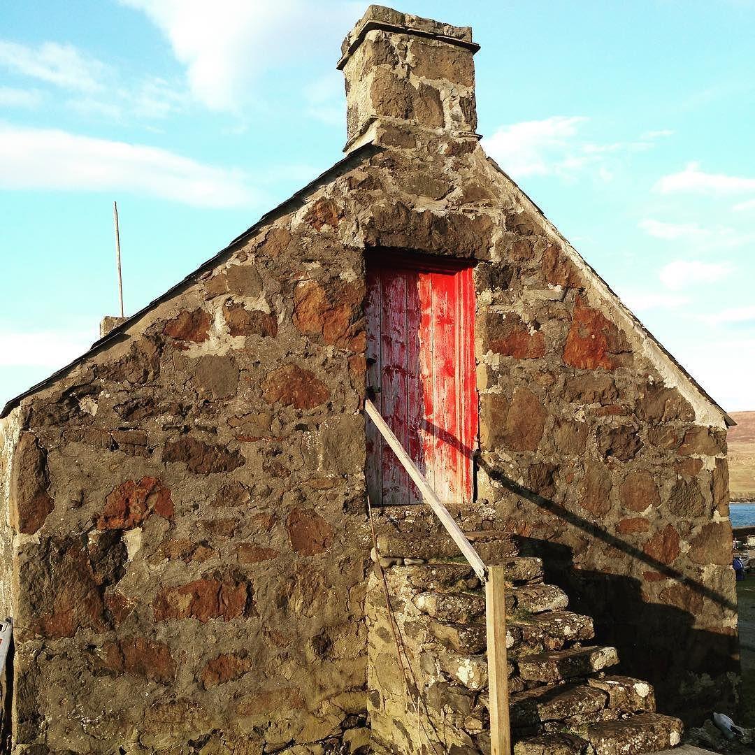 Boat shed at Milovaig Pier. #skye #isleofskye #building #brickhouse #stone #reddoor #woodendoor #woodwork #blueskies #staircase #shed #seashore #pier de eng1170