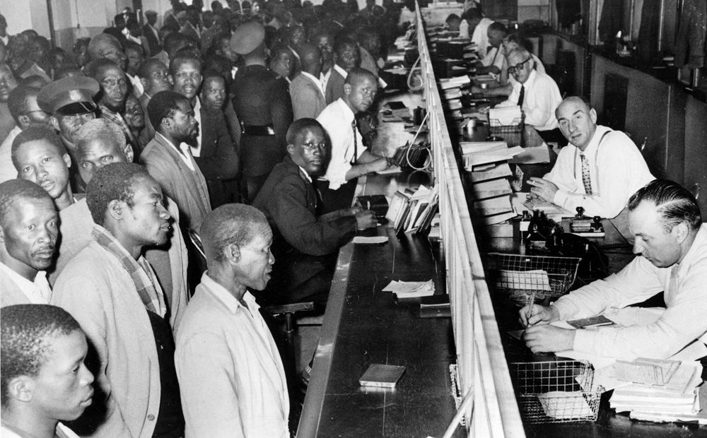 Black South African Line Up At The Counter A Government Office To Get Their New Passbook In Johannesburg S Apartheid Africa Era Essays