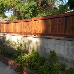 Photo Of Wood Fence Expert Los Angeles Ca United States Custom Floating Wood Privacy Fence Above Short Concret Patio Fence Wood Privacy Fence Wood Fence