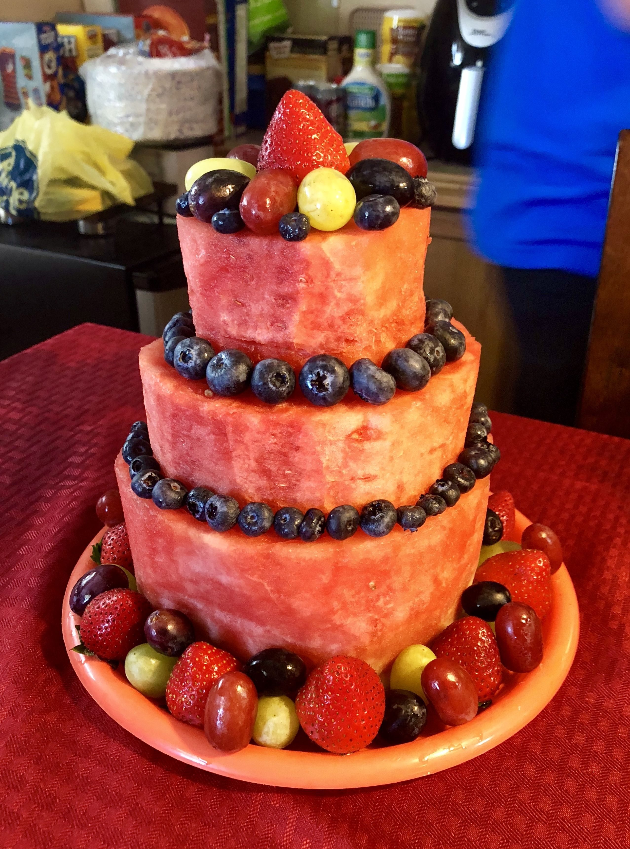 Fruit cake watermelon grapes blueberries and