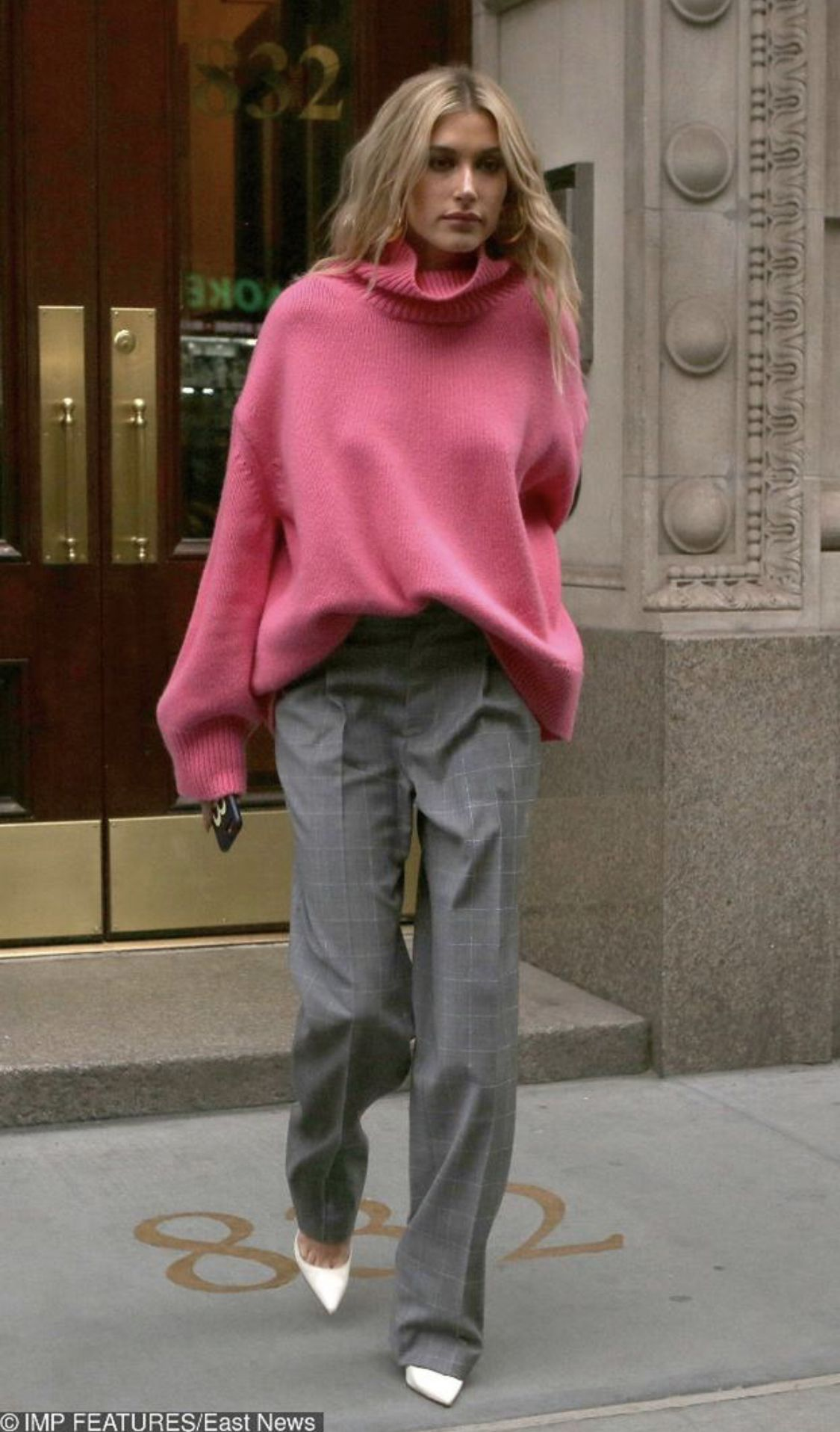 Hailey Baldwin in pink jumper & grey suit