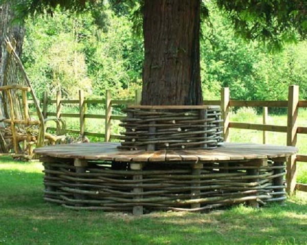 A natural style bench using wattle edging around a great for Tree edging border ideas