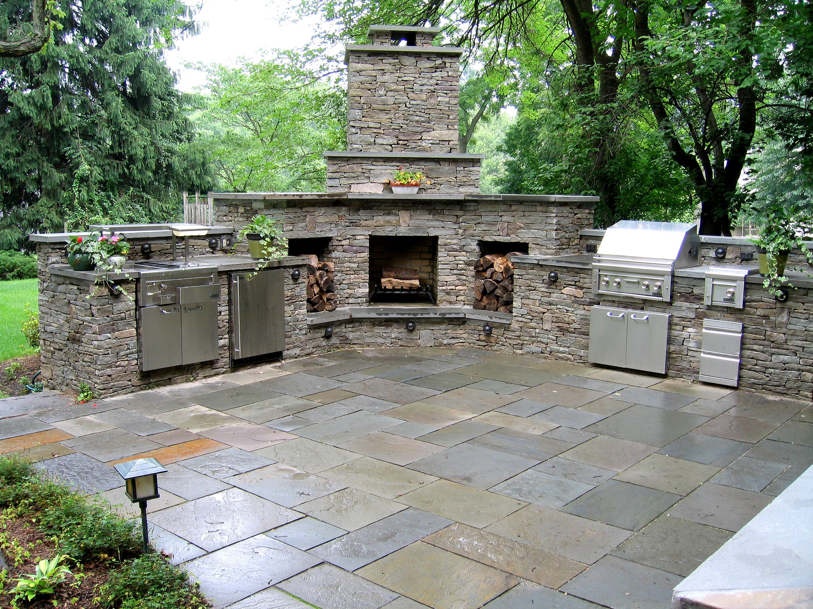A Pavilion With An Outdoor Kitchen Fireplace And An Entertainment System Backyard Fireplace Outdoor Covered Patio Outdoor Kitchen Design
