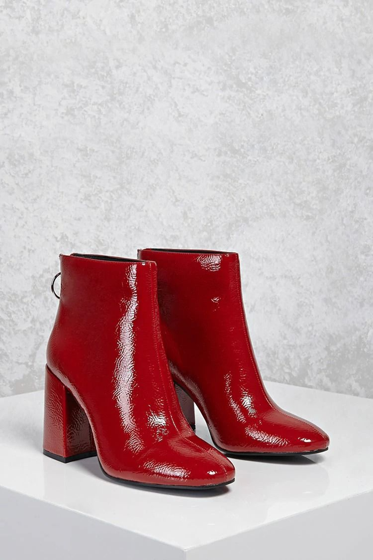 26f86f3fd79 A pair of textured faux patent leather ankle boots featuring an almond toe
