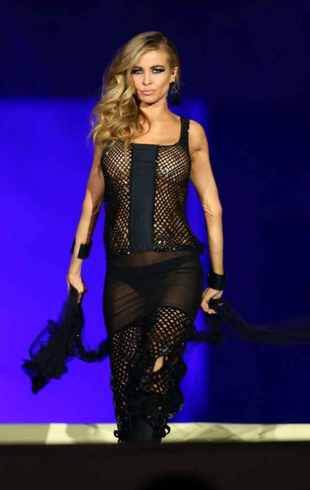 f4a714eb8fdb Carmen Electra walks the runway during the Life Ball 2015 show at City Hall  on May 16, 2015 in Vienna, Austria. (Photo: Mathias Kniepeiss/Life Ball ...