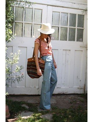Love the sweet 70's look of high-waisted jeans, a big hat, and stripes.