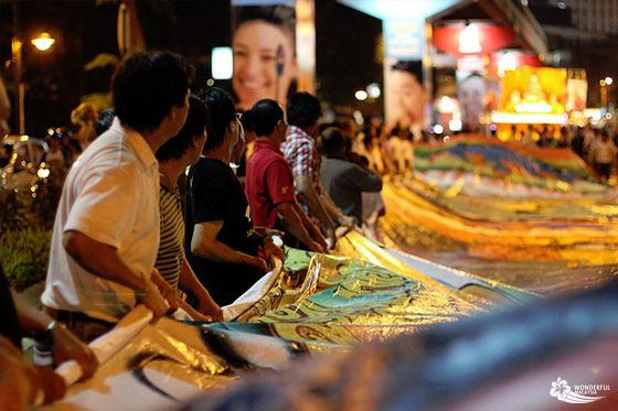 Many Buddhists holding an image of a huge dragon at the Wesak Day (Vesak Day) parade in Kuala Lumpur, Malaysia.