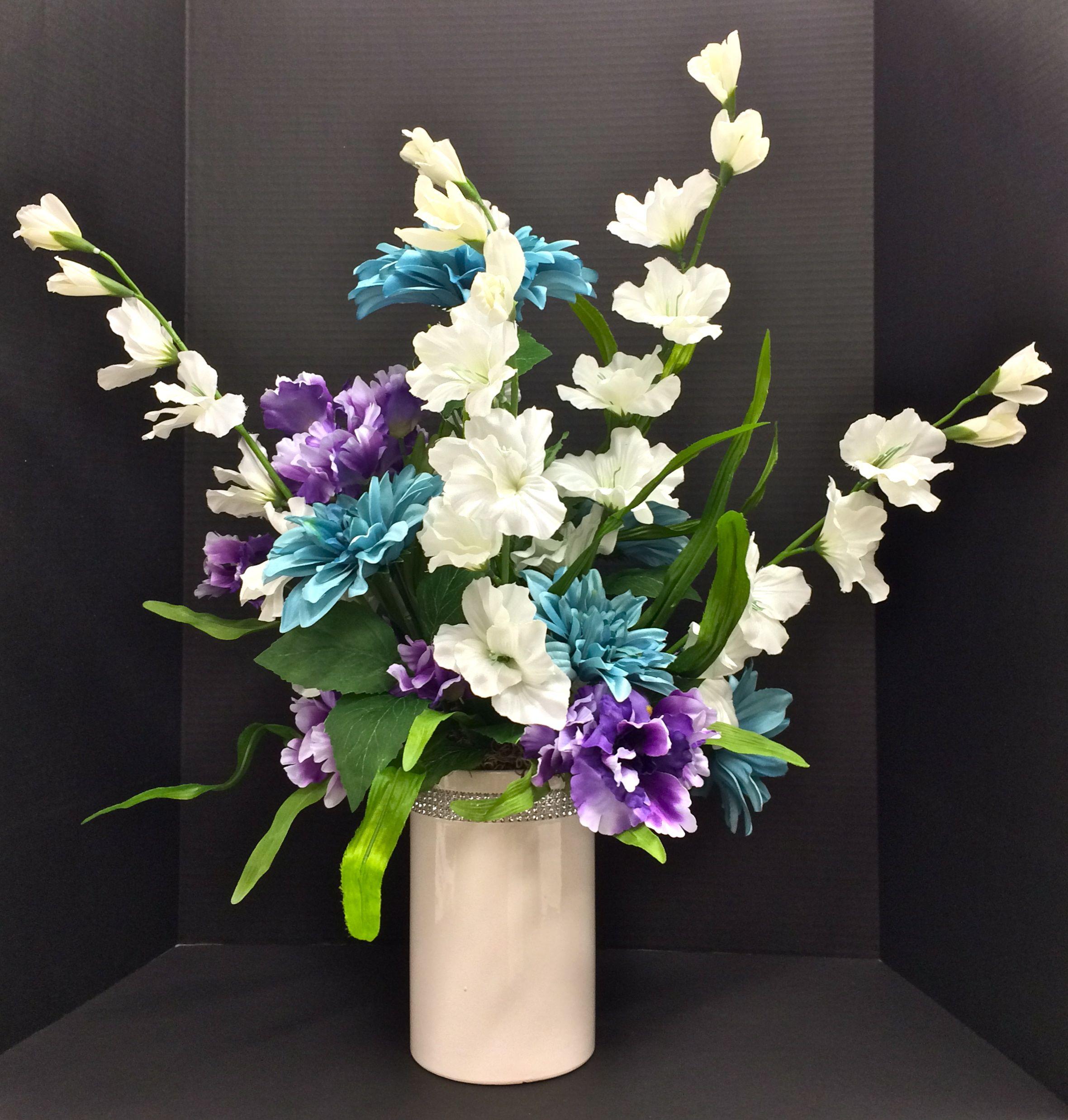 Spring 2015 Season tabletop: Blue Dahlias, White Gladiolus and Violet Iris on 8 inch ceramic jeweled white cylinder vase. Original design and arrangement by http://nfmdesign.synthasite.com/