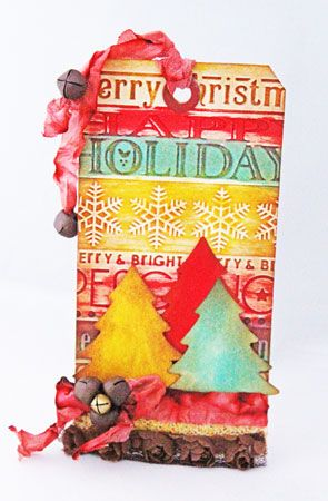 Christmas tags are one of my favorite projects to work on. They're super fun and they serve so many purposes. For this tag, I used texture as my inspiration. To carry texture throughout, I used embossed elements, stained and dimensional ribbon, metal bells, 3-D trees and uneven application of Distress stains. All of them offer texture physically an...