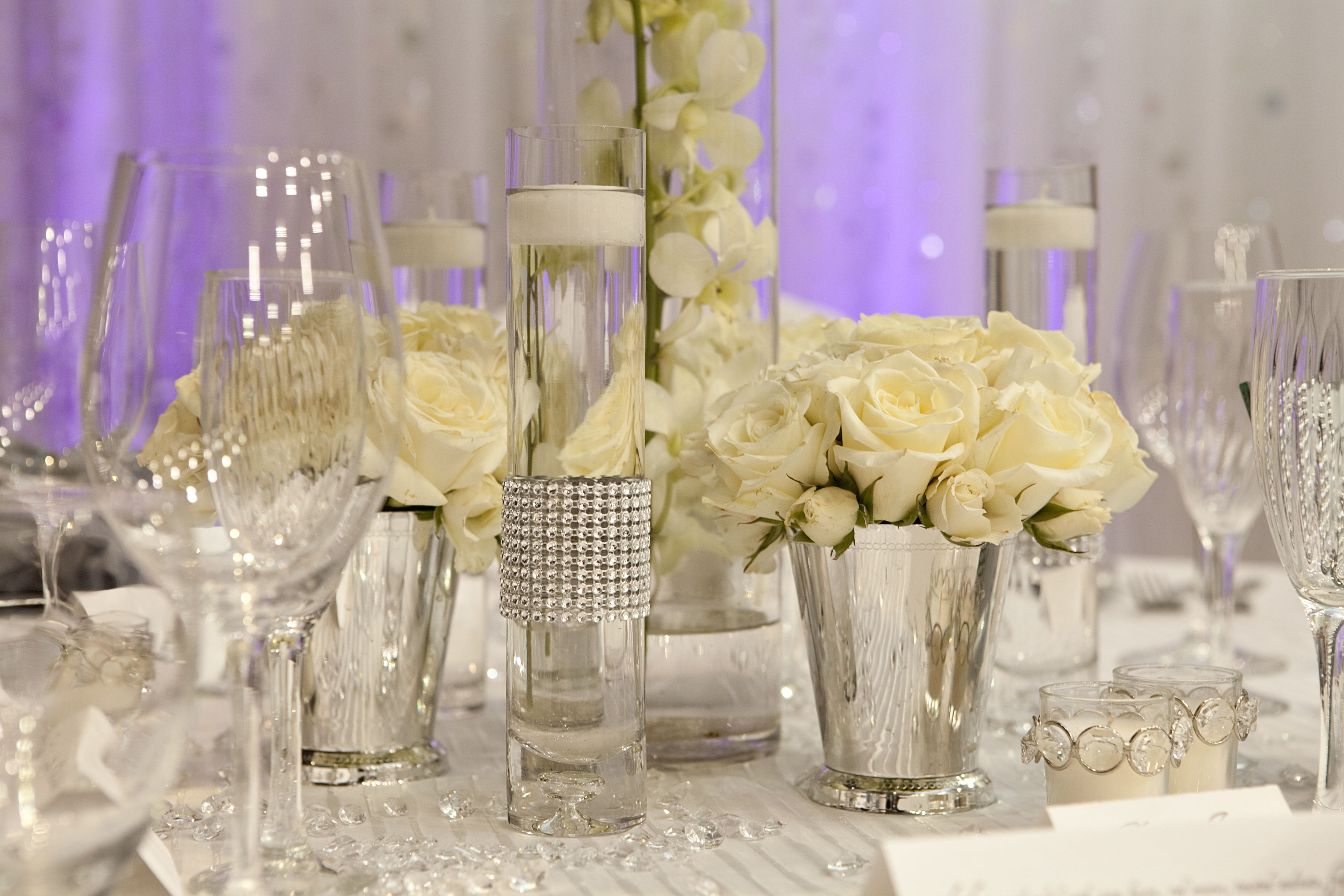 All Blinged Out We Rent The Bling Rings And Swarovski Crystals For The Tables Wedding Flower Arrangements Wedding Expenses Wedding Centerpieces