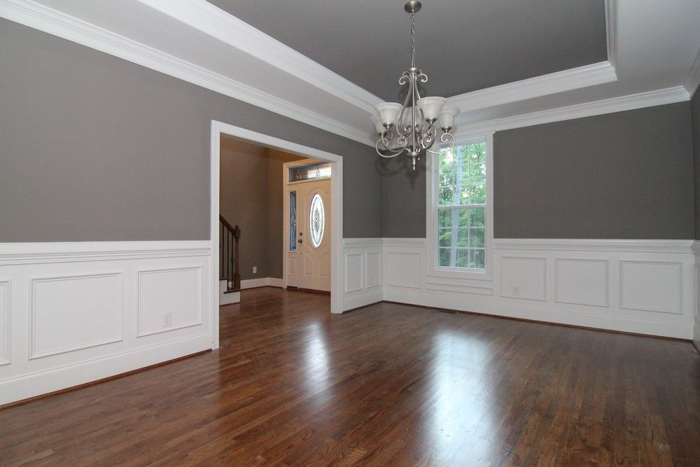 White Wainscoting Walls In The Formal Dining Room With Sw 7018 Dove Tail Grey Paint Above Trim And Trey Ceiling