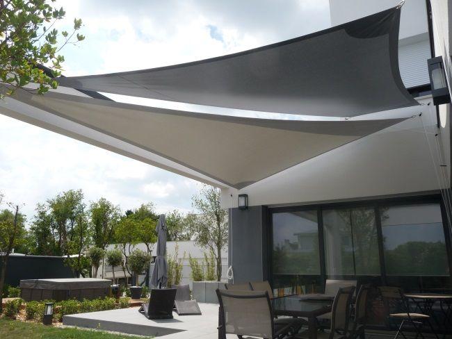 Voiles d 39 ombrage triangulaires carr es et rectangulaires for Toldos para patios pequenos