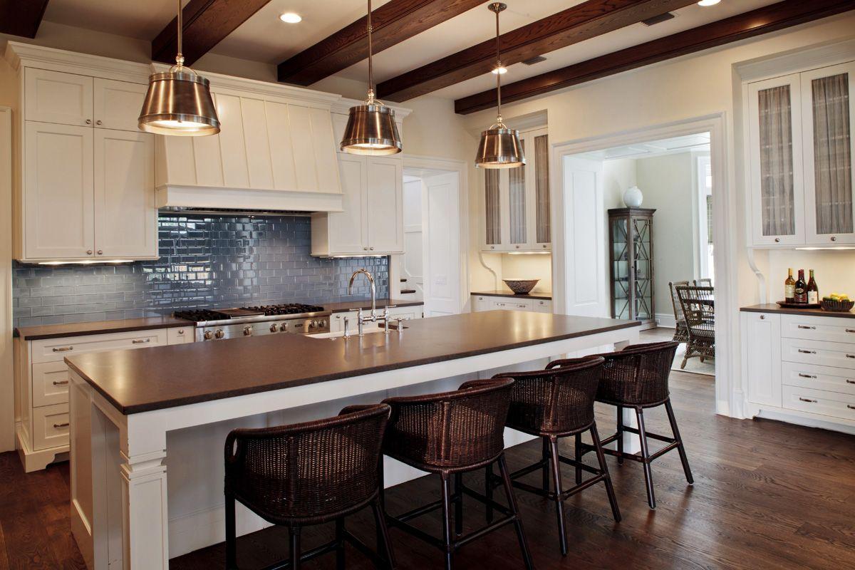 rustic cottage kitchen exposed beams pendants backsplash