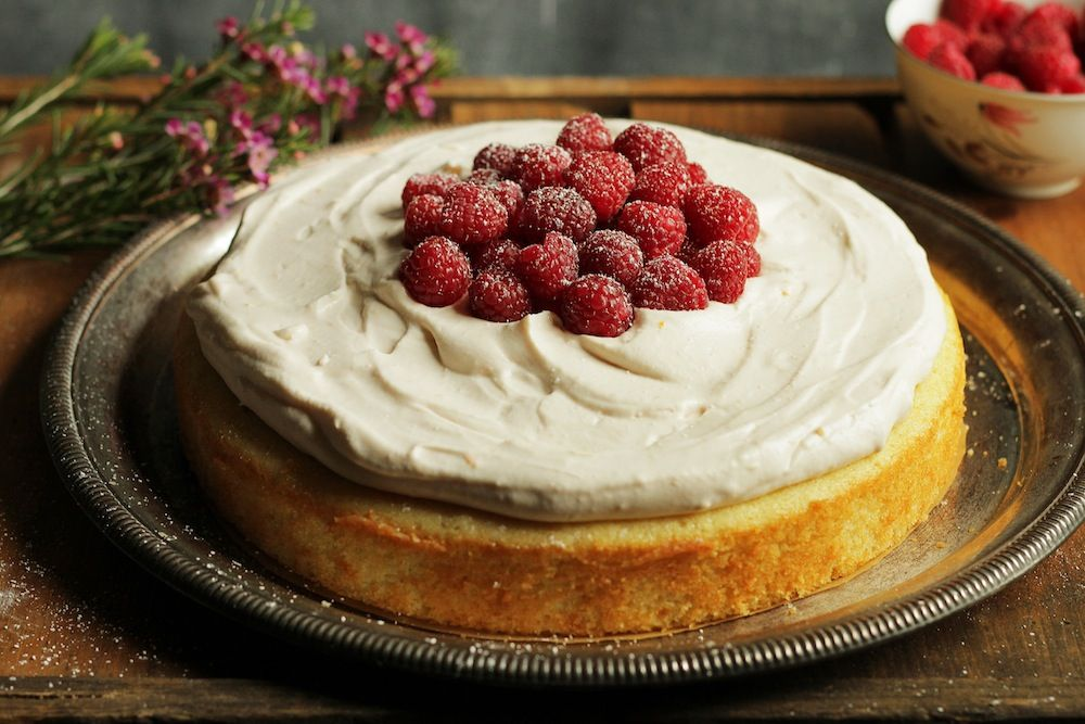 A delicious buttermilk cake frosted with a blood orange cream.