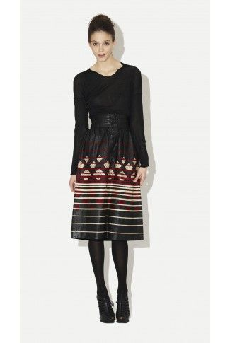 This Lanvin leather embroidered skirt from the late 1970's. It is styled with Yigal Azrouël Basic Long Sleeve Shirt, Wolford Tights, and YSL Wedge Boots.