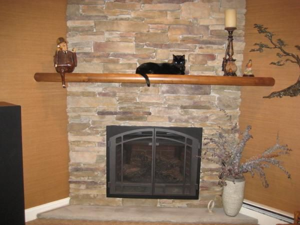 Wooden Fireplace Mantels Decorating With Candle And Black