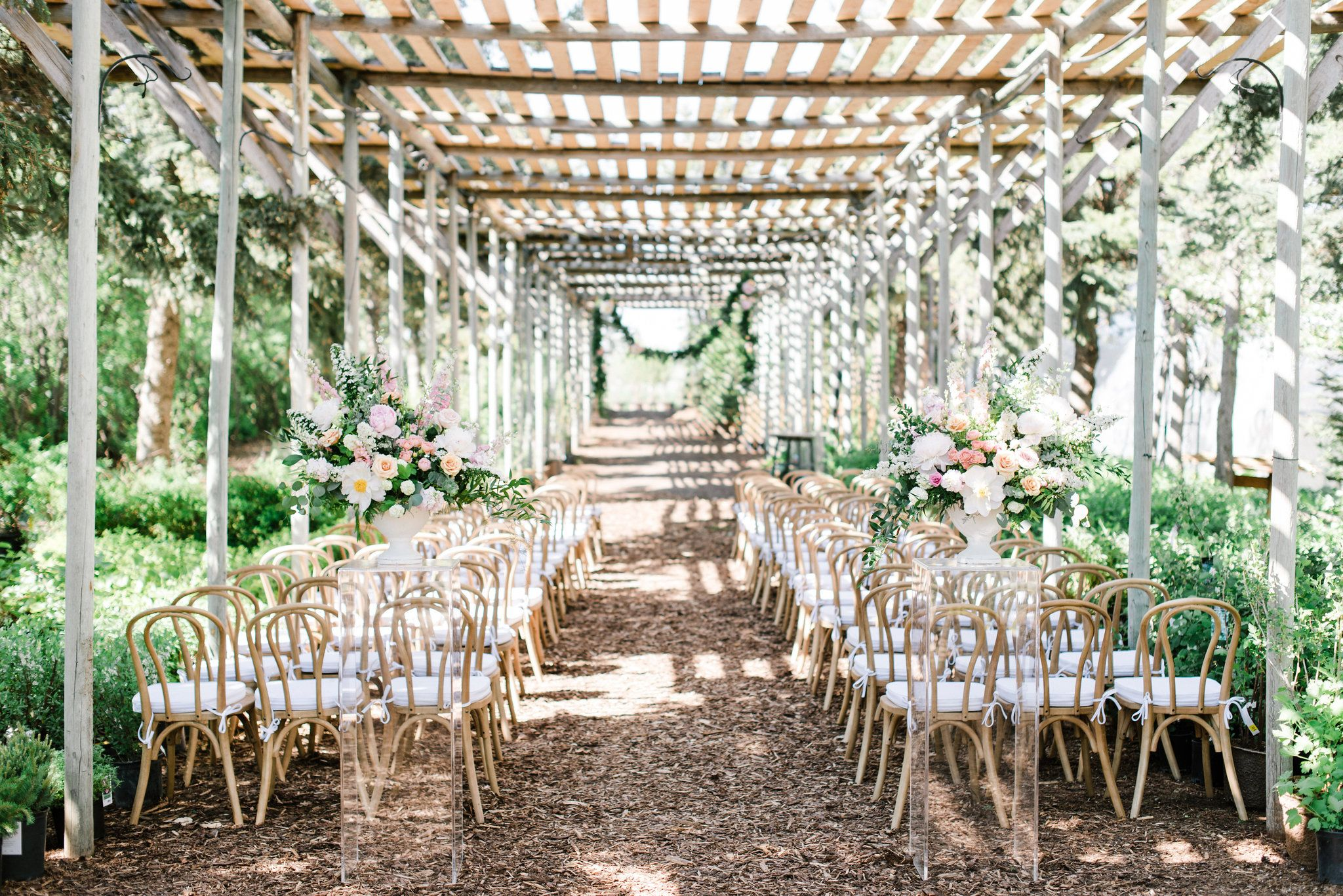 Outdoor Wedding Ceremony At The Saskatoon Farm With Hanging Floral