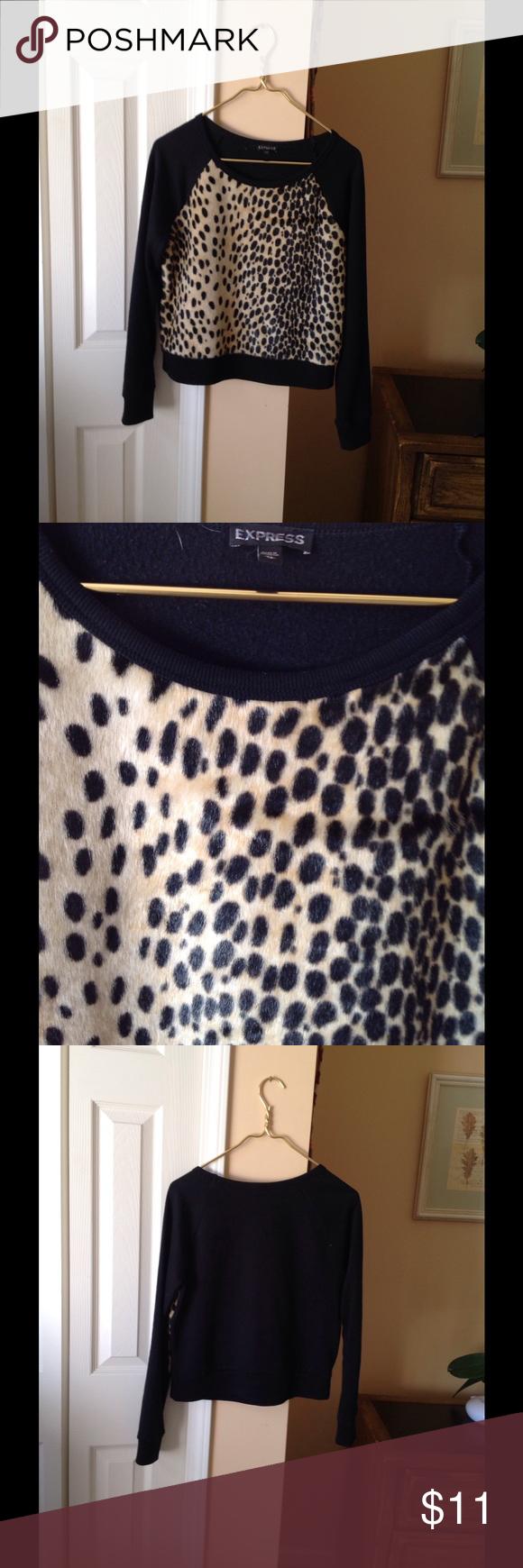 Express Leopard Sweatshirt Cute leopard print sweatshirt with fuzzy leopard front panel. Excellent used condition. Express Tops Sweatshirts & Hoodies