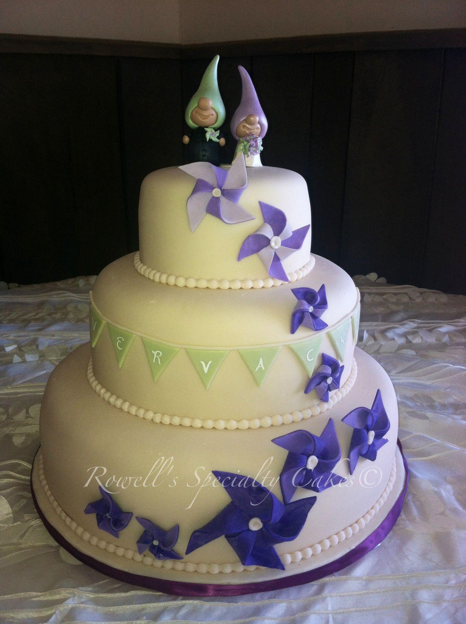 Rowell's specialty cakes, Purple wedding cakes, gnomes wedding cakes, pinwheels, banners, wedding cakes