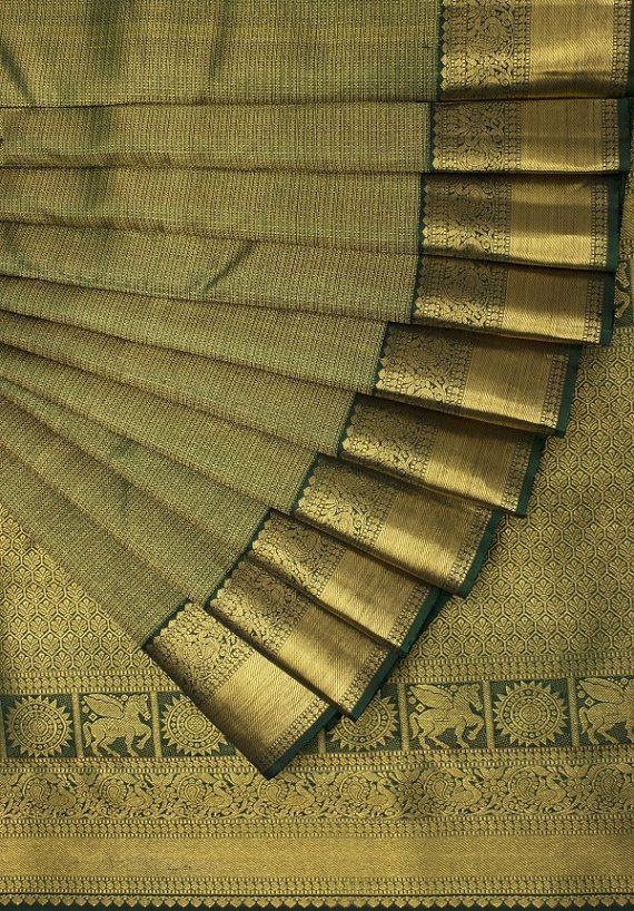 Photo of Items similar to Incredible India! Royal Saree! Hand Loomed Pure Kanchipuram Silk Saree – Pure Gold Zari Work – Forest Green & Gold. FREE WORLD SHIPPING! on Etsy
