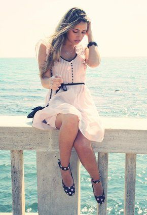 A pretty, delicate pink dress with polka dot pumps