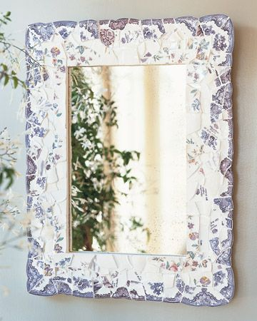 The broken rims of plates can be used to create the scalloped curves edging this mirror frame. An assortment of off-white and floral fragments gives the frame a variegated effect.