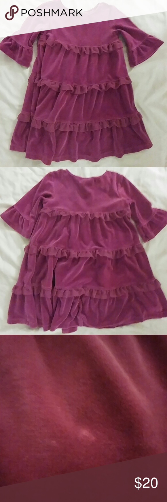 """Hanna Andersson """"Love to Twirl"""" magenta dress Lovely and sweet, this Hanna Andersson dress is perfect for the little girl in your life. In stylish magenta velour, it's decorated with 3 tiers of tulle ruffles. The sleeves are 3/4 length, there's satin trim around the neck, and it features a slightly raised waist.  The size is 110, which (according to Hanna Andersson's site) equals a US children size 5 - 6x. Hanna Andersson Dresses Casual"""