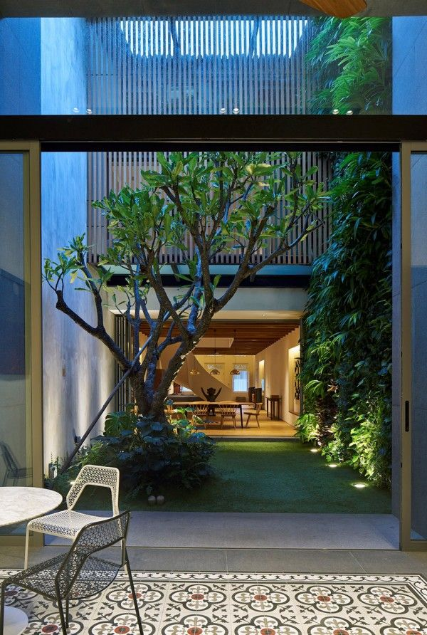 A CenturyOld Home in Singapore Becomes a Modern Masterpiece is part of Indoor courtyard - A centuryold home in Singapore has been restored into a stunning modern mansion, the 17BRHouse by Ong&Ong Architects  This long, threestory home