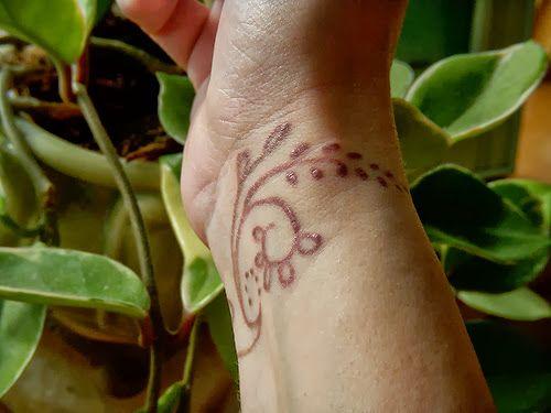 freehand henna tattoo wrist vine