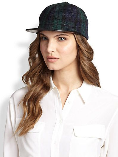 Sporty-chic plaid wool hat finished with a sleek leather brim and decorative top button. #littlesalebirdy