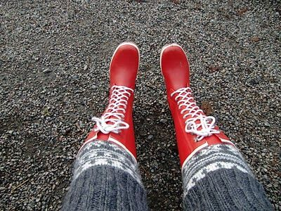 Red Viking boots for rainy wether and long knitted socks.