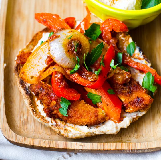 Skillet-hot, salsa-tossed peppers, onions and protein over top hummus-slathered toast. Fuss-free lunch!