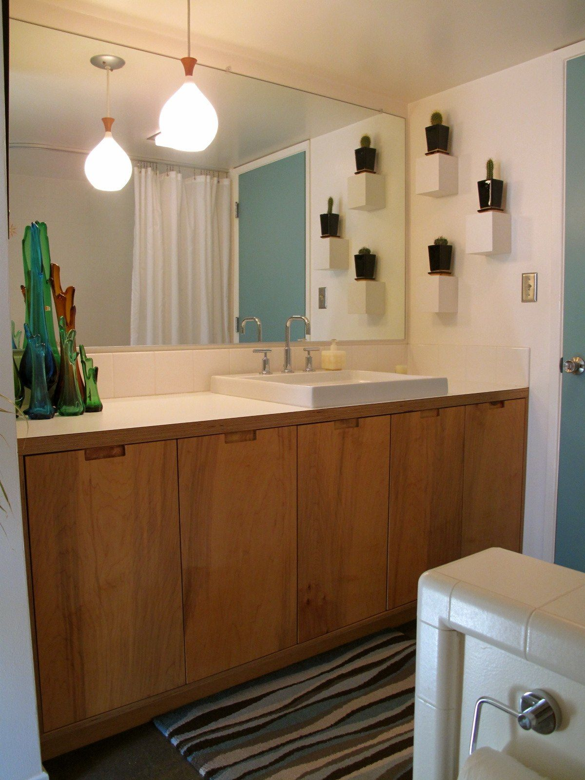 Mid Century Bathroom With Glass Vases