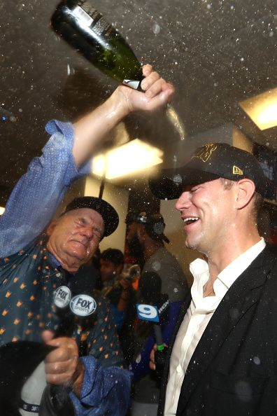 be53a11335a Actor Bill Murray celebrates in the clubhouse with President of Baseball  Operations for the Chicago Cubs Theo Epstein after the Cubs defeated the.