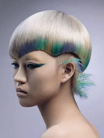 Silver ash blonde, with dipped pastel shades. undercut, one length curved helmet cut, not for the faint hearted .
