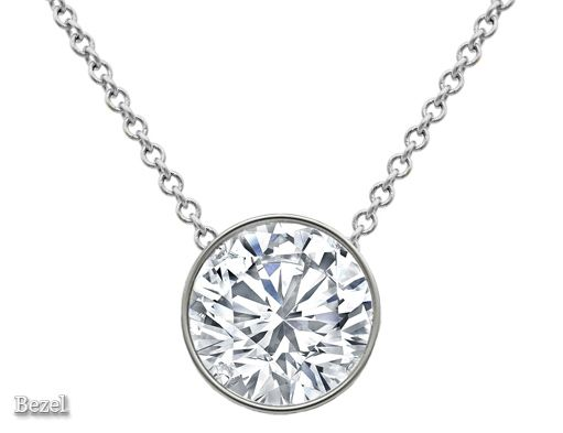 Floating round diamond solitaire pendant necklace click to this round diamond necklace pendant in our lovely solitaire diamond pendant necklace collection is a timeless present to suit any wardrobe aloadofball Image collections
