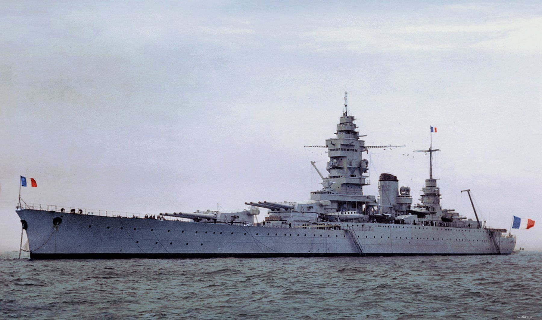 Dunkerque was the lead ship of the Dunkerque class of battleships built for the French Navy in the 1930's. The class also included Strasbourg. The two ships were the first capital ships to be built by the French Navy after World War I. (Rare color photo)
