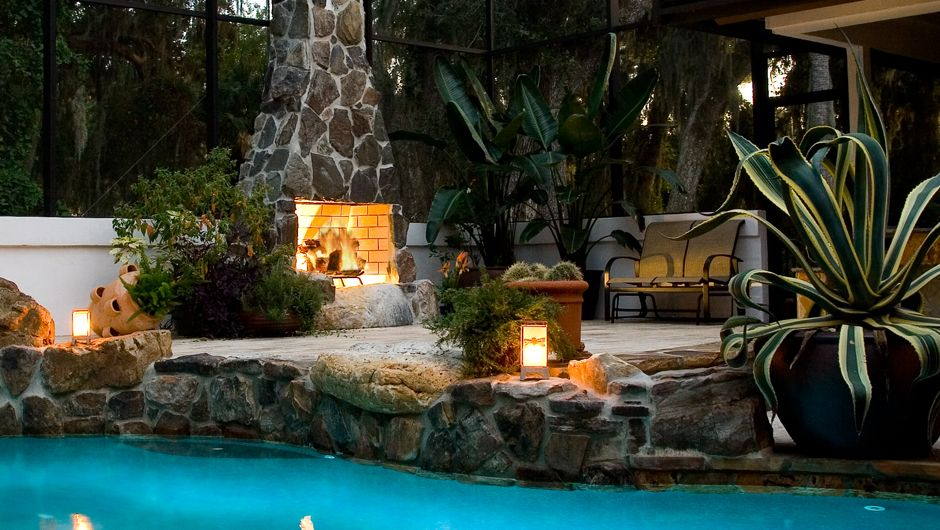 Poolside On A Covered Patio With A Roaring Fireplace Perfection Isokern 36 Standard Outdoor Fireplace Installed By E Outdoor Living Outdoor Outdoor Oasis