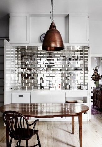 Love it!  If your kitchen doesn't get a lot of natural light, metallic wall tiles can help bounce light around and make your space brighter (same for a bathroom)