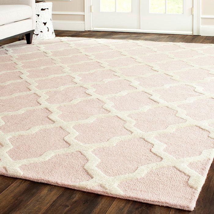 blush pink rug looks so good on those dark wooden floors | Home is ...