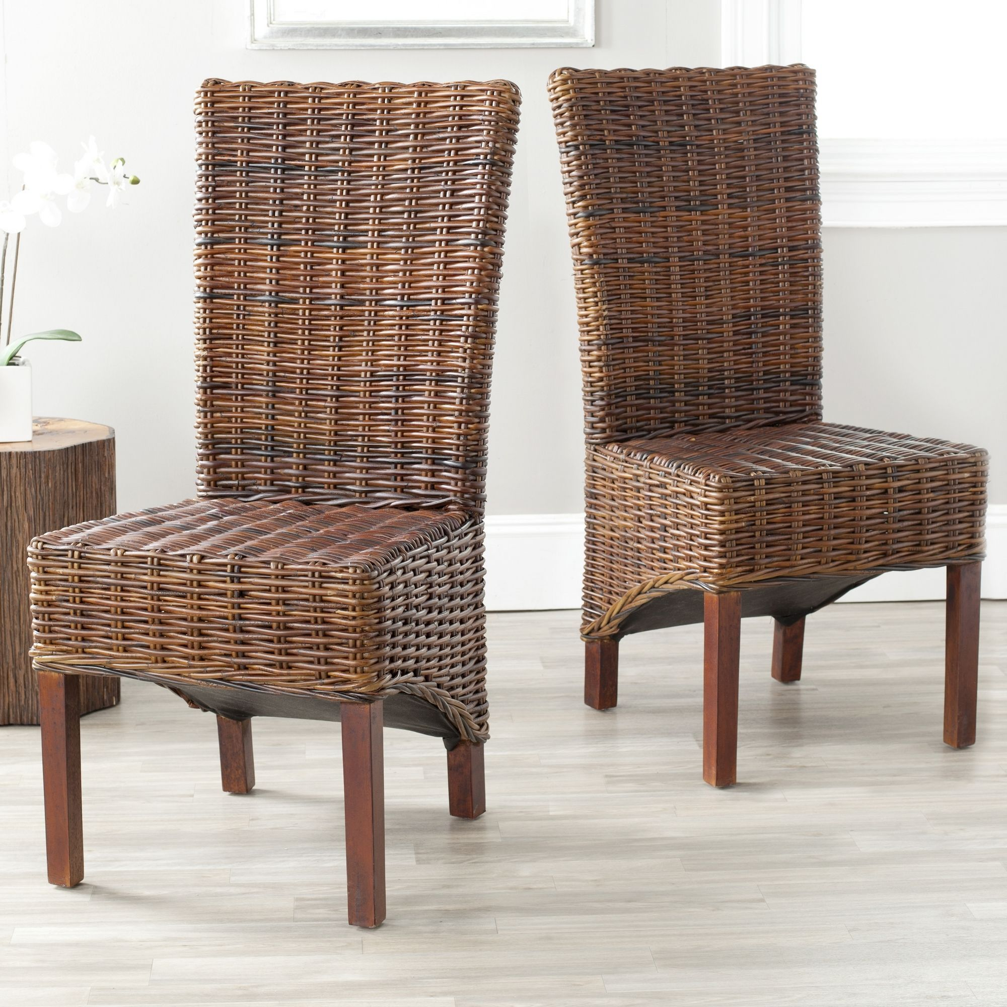 Freshen up your decor with this set of two safavieh brown rattan wicker chairs the mango wood legs and woven wicker create these sturdy seats that are