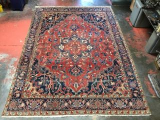 """Antique Heriz rug circa 1900. Nice design and rich natural dyes. Shabby chic! Size: 9'1"""" x 12'4"""". The pile shows wear in the field, but the sides and ends are in excellent  ..."""
