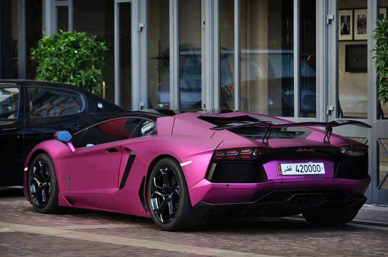 a metallic pink sports car